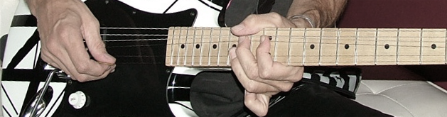 playing EVH Strat guitar